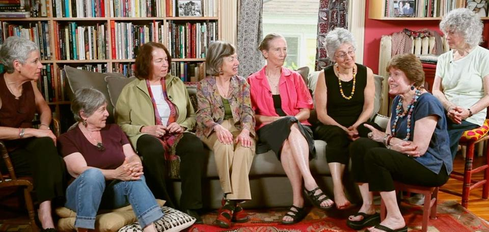 "Judy Norsigian (third from right), one of the founders of ""Our Bodies, Ourselves,"" had hoped to transition to grandmothering soon but will now lead the board of the organization."
